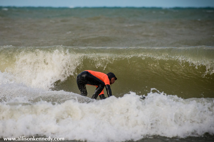 Larry Cavero finds a rare barrel in Sunday's swells. Cavero finished third in the shortboard division.