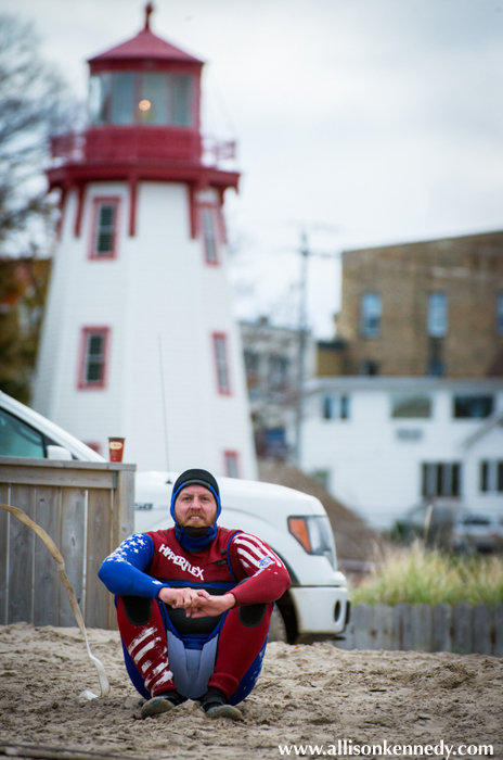 New York's Scott John's poses for a perfect Canadian postcard: Iconic Kincardine lighthouse complete with Timmy's cup in the background.