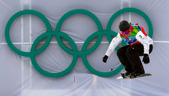 Maelle Ricker clears a jump on her way to gold in West Vancouver, B.C., on February 16, 2010. Snowboardcross was the most hazardous sport at the Winter Olympics in Vancouver, with nearly 75 per cent of female athletes sustaining injuries during the rough-and-tumble races, according to a medical study. THE CANADIAN PRESS/Sean Kilpatrick.