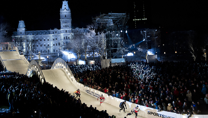 Athlets perform during the finals of the Red Bull Crashed Ice, the last stop of the Ice Cross Downhill World Championship in Quebec, Canada on March 22, 2014. Andreas Schaad/Red Bull Content Pool.