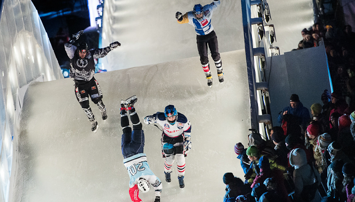 Toni Keikkila of Finland, Coleton Haywood of Canada, Markus Juola of Finland and Tyler Roth of Canada perform during the finals of the Red Bull Crashed Ice, the last stop of the Ice Cross Downhill World Championship in Quebec, on March 22, 2014. J??rg Mitter/Red Bull Content Pool.