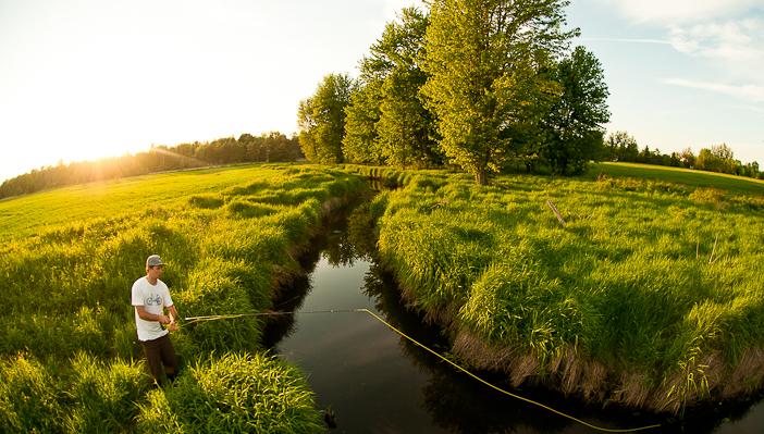 Alija Bos, self-portrait, flyfishing near Innisfil, Ontario.