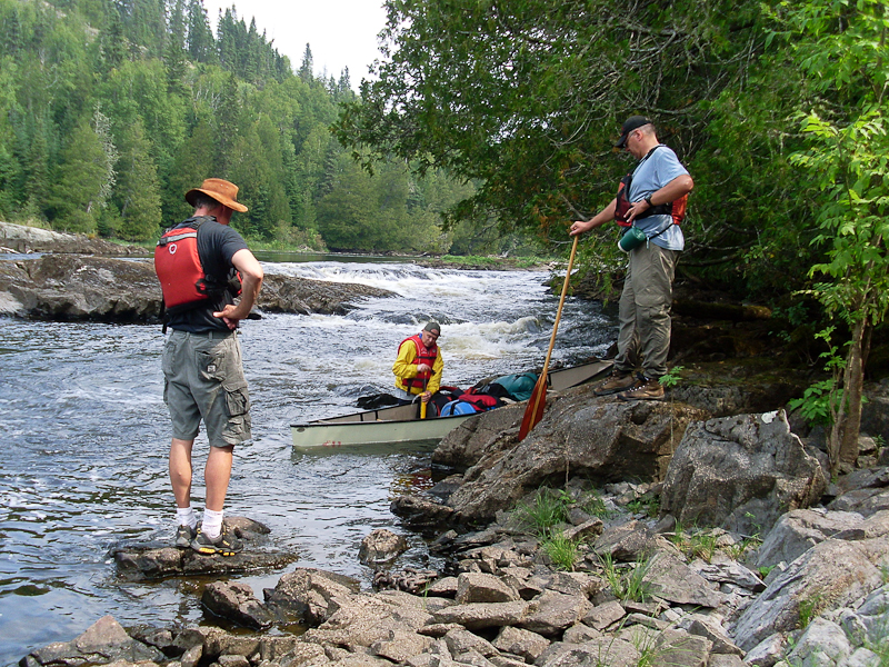 Scouting Rapids on the White. Photo courtesy Andy Christie.
