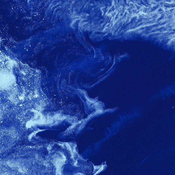 Like galaxies amid clouds of interstellar dust, chunks of sea ice drift through swirls of grease ice in the frigid waters of Foxe Basin near Baffin Island. Courtesy NASA Goddard Space Flight Center.