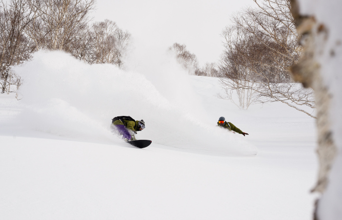 Lopez (left) and Tamai surf snow. Photo courtesy Patagonia.