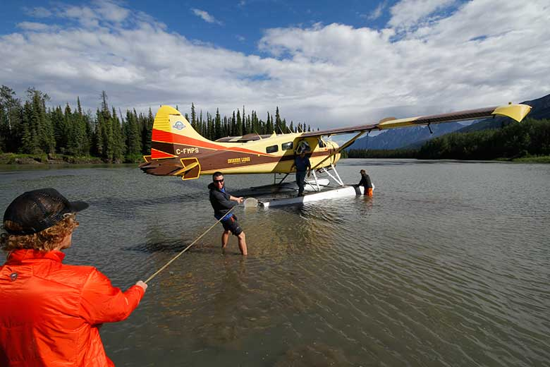Sean and Tim steady the floatplane on the Nahanni River en route to a skydive exit down to Vampire Lake.