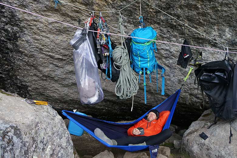 Tim kicks back and enjoys the views of basecamp in Fairy Meadows, Cirque of the Unclimbables. Trevor McDonald photo.
