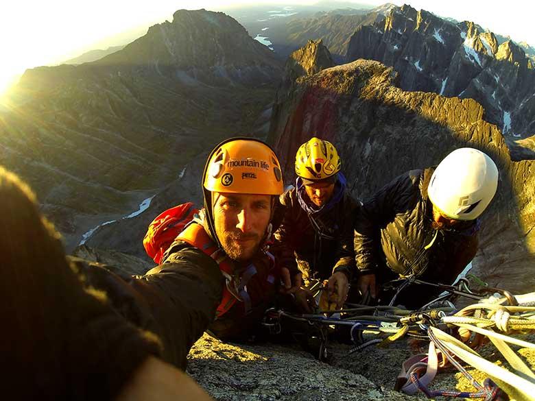 Sunrise on one of the best routes on the planet. Jimmy, Trev and Scott take in a bit of warmth while rappeling down from a successful climb on Lotus Flower Tower.