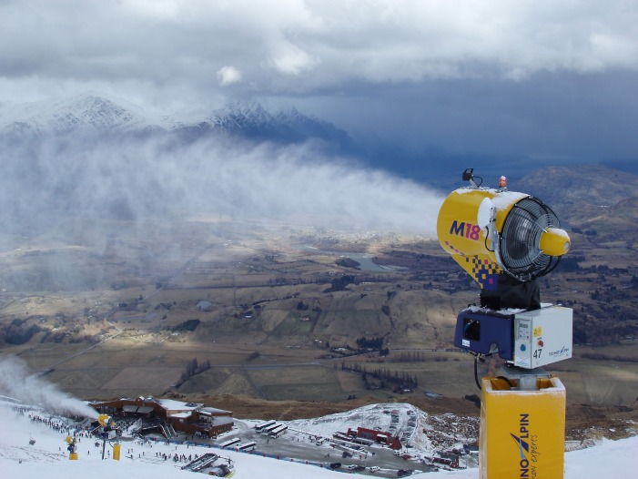 a snowmaker blows man made snow onto the piste, new zealand