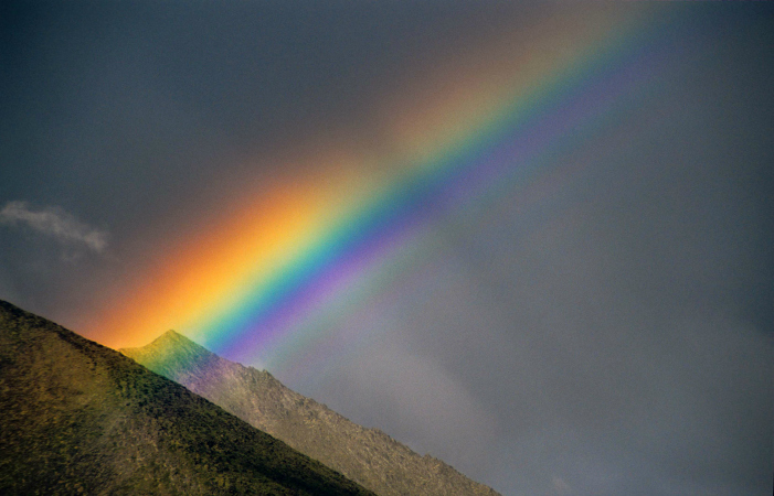 A rainbow touches a mountain summit on the Hart River. Photo by Juri Peepre/courtesy ProtectPeel.ca