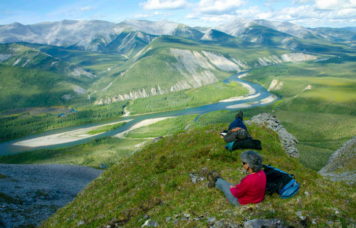 Sarah and Troy relax on one of the many wanders into alpine terrain above the Hart River. Photo by Juri Peepre/courtesy ProtectPeel.ca