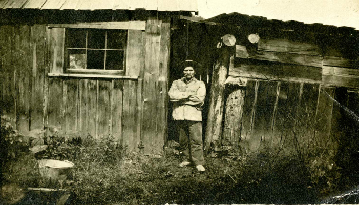 John Millar outside his stopping house, 1911. Before the railway came to the valley, John Millar owned a stopping house along the Pemberton Trail. He is remembered as an excellent cook, despite being known to serve up a dish of muskrat stew or haunch of bear to weary travellers.