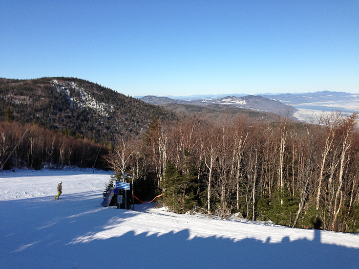 Near the top of Le Massif, the Charlevoix mountains stretch into the far distance. Photo by Mountain Life Media.