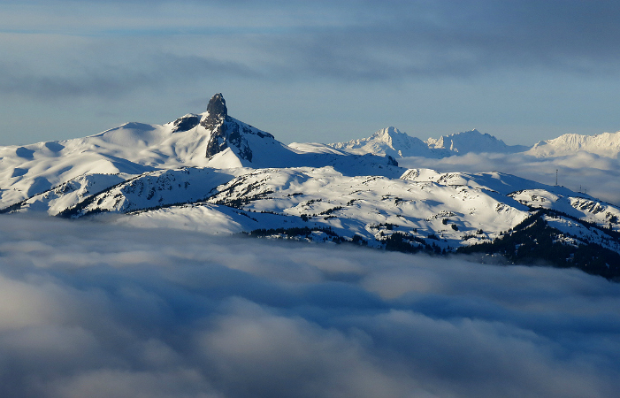 Sunrise over the Tusk and Tantalus range Islands in the Sky morning at work grooming on Whistler Mountain.
