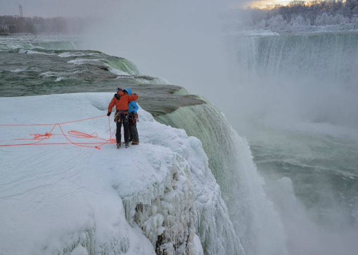 Will Gadd and Sarah Hueniken folllowing their first ascents, during Red Bull Frozen Falls at Niagara Falls, NY, on 27 January, 2015. // Keith Ladzinski / Red Bull Content Pool .