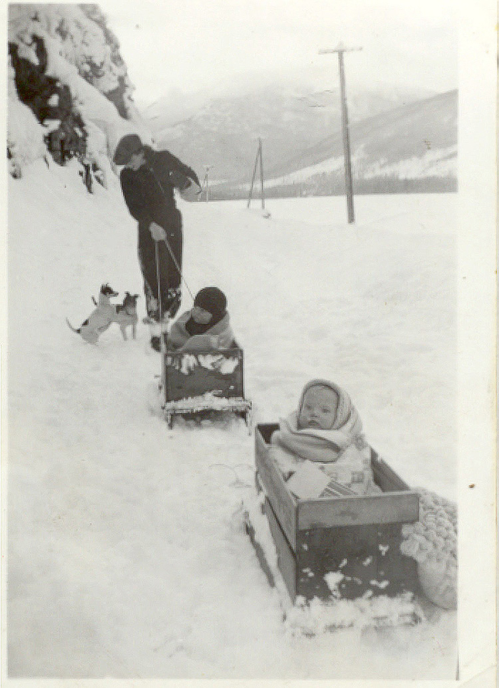 Louise Betts and another baby in home-made sleighs made out of crates. Courtesy Whistler Museum.