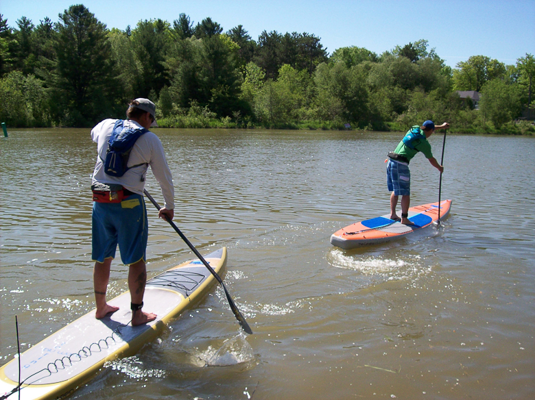Petersen (I) and Aaron Pilon of Blu Wave Paddleboards take a test run. Blu Wave is sponsoring Peterson's Ontario expedition.