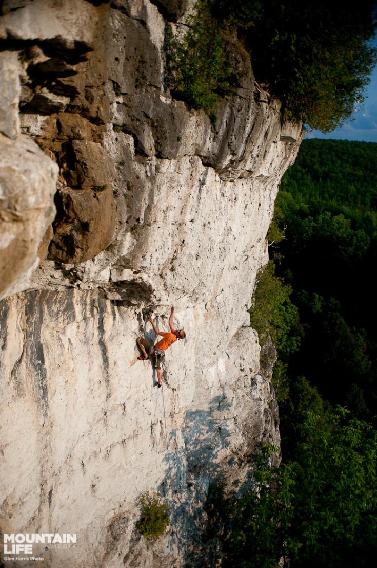 Chris Pegelo climbs White Lightning, a 5.12b mixed route at Metcalfe Rock. Glen Harris photo.