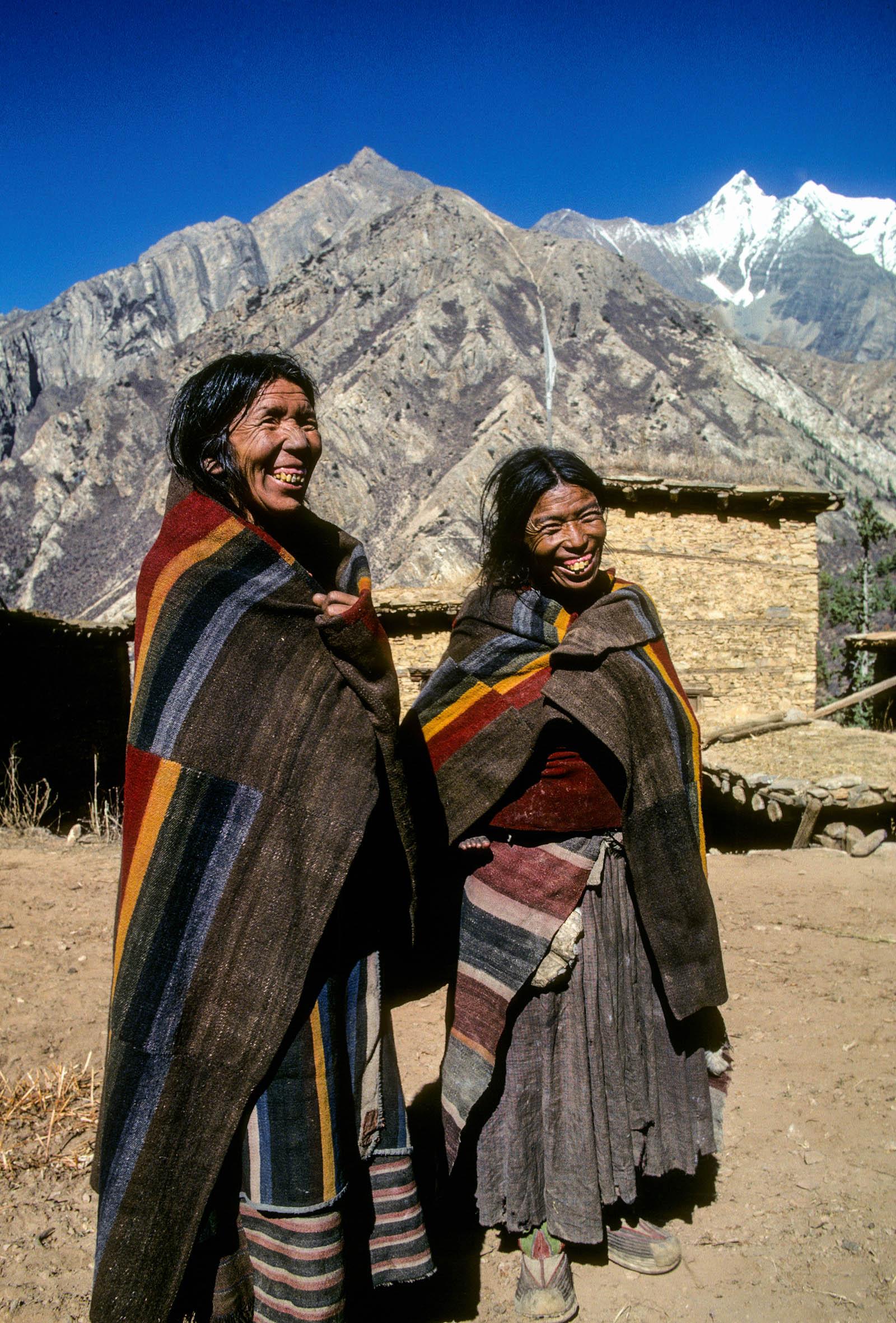 "Women in village of Murwa wear distinctive ""Dolpo blankets"", Shey Phoksumdo National Park, Dolpo region, Nepal 1990"