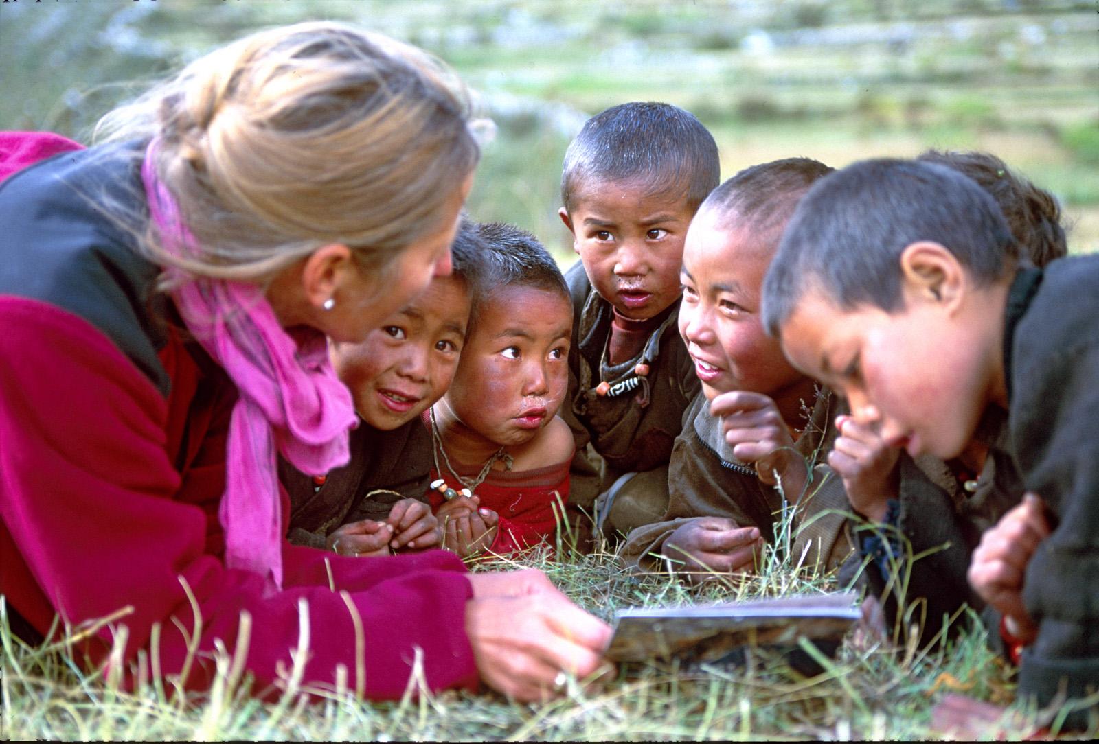 Baiba breaks the ice by sharing photos of the Canadian Rockies in village of Samagaon, Manaslu area. Nepal. 1994.
