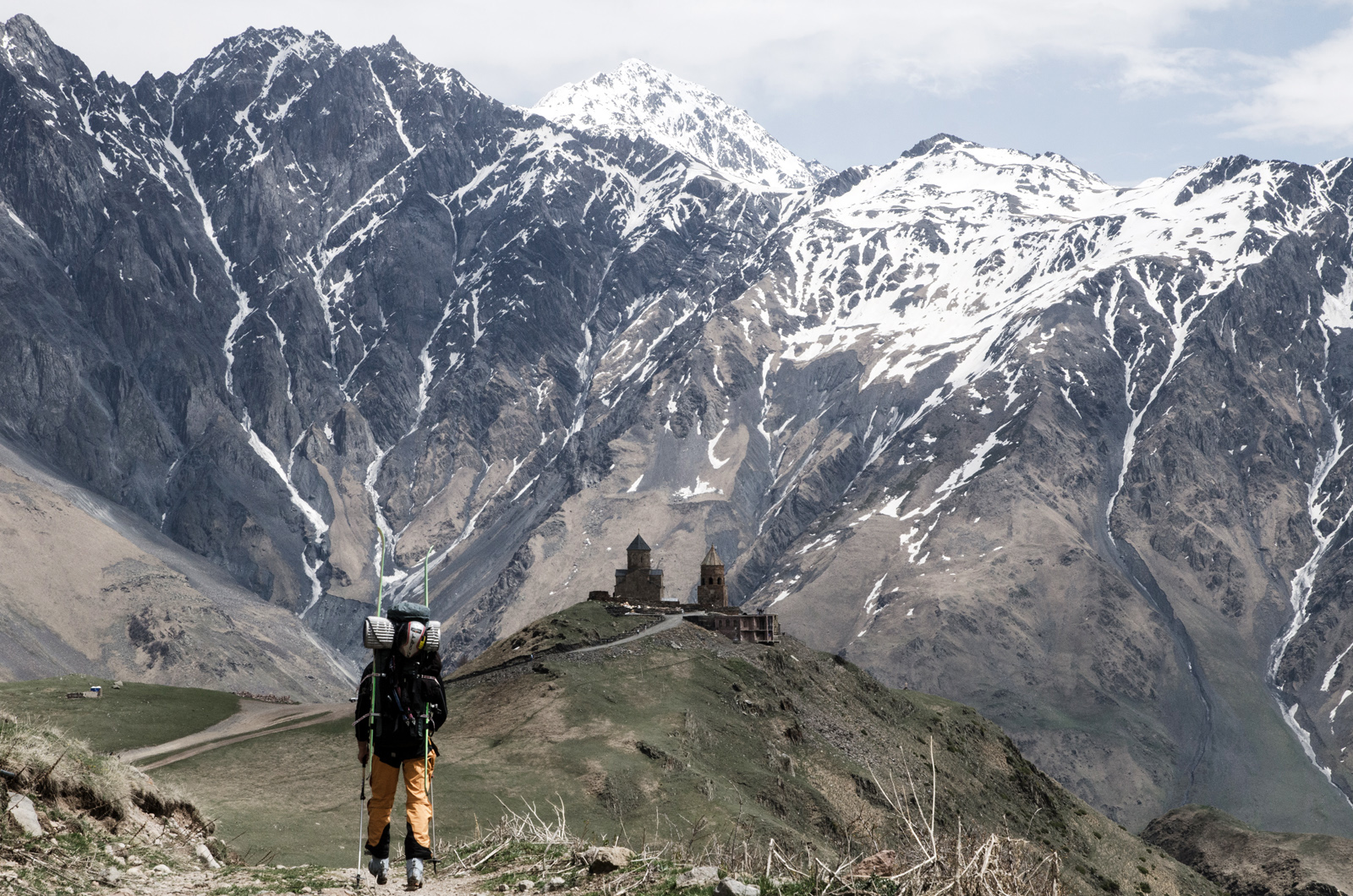 """Returning to the valley on our fourth day on Mount Kazbek. ""This photo summarizes why we go on ski expeditions. Strolling down ancient mountain roads in our ski boots, exhausted from having skied a line that no one has skied before."" TREVOR HUNT PHOTO"