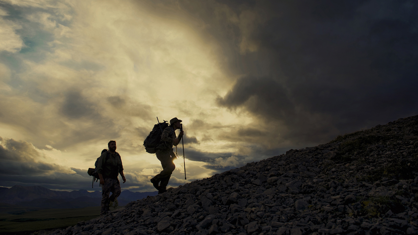 Well past midnight, Dan and Glenn Stevens of Mackenzie Mountain Outfi tters climb the day's last ridge looking for a spot to hunker down for the night.