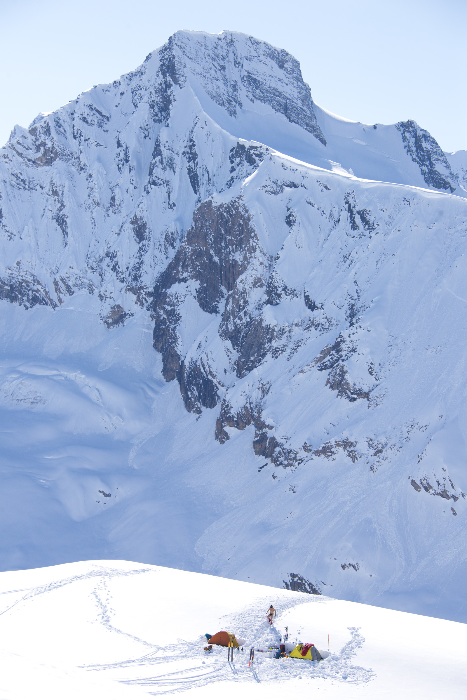 "Farnham Creek ""ski camp"" April 28-30, '14; Brett Eyben getting some rays; The Cleaver peak behind and part of Farnham Glacier visible to left"