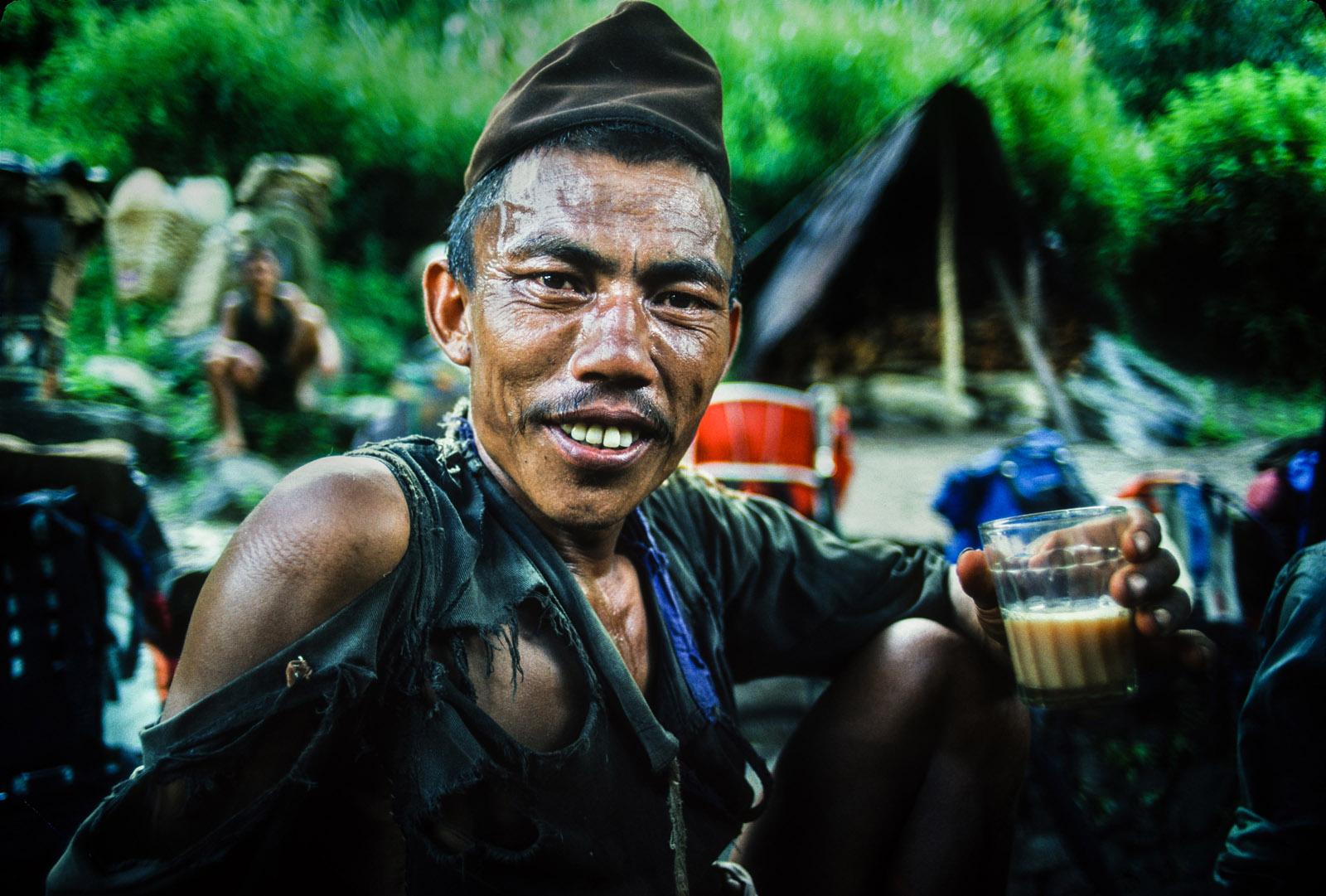 Porter takes a tea break during trek from Kathmandu to Everest base camp, during first Canadian Everest expedition. Nepal. 1982.