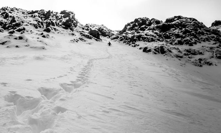 Spring in South Central Alaska. Tucker Chenoweth climbing Mount Rumble, Western Chugach Mountains. . Photo: Joe Stock.
