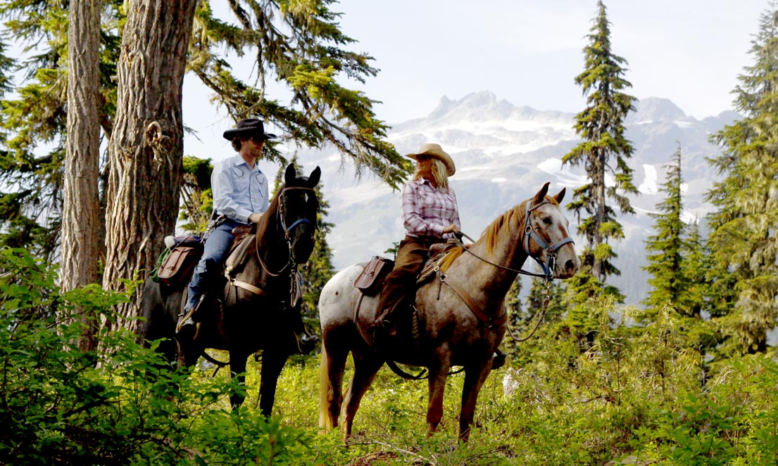 Horseback riding in the Callaghan Valley near Whistler, BC.