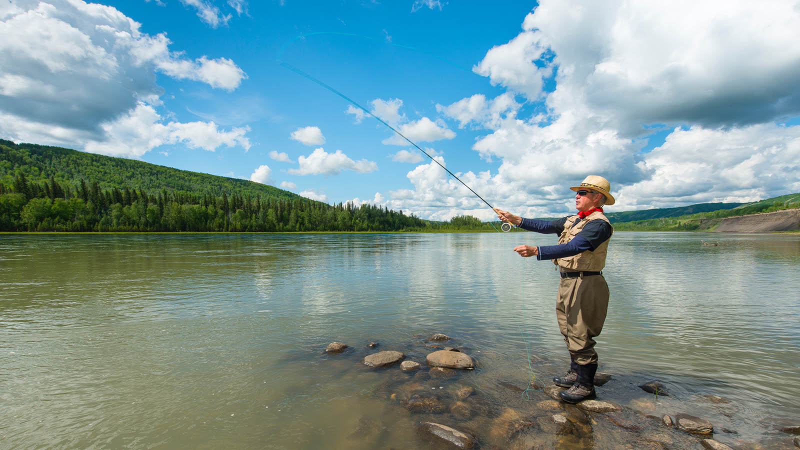 Ross Peck fishes on the Peace River in front of his farm. Ross raises horses and grows wheat and canola on land that will be flooded by Site C.