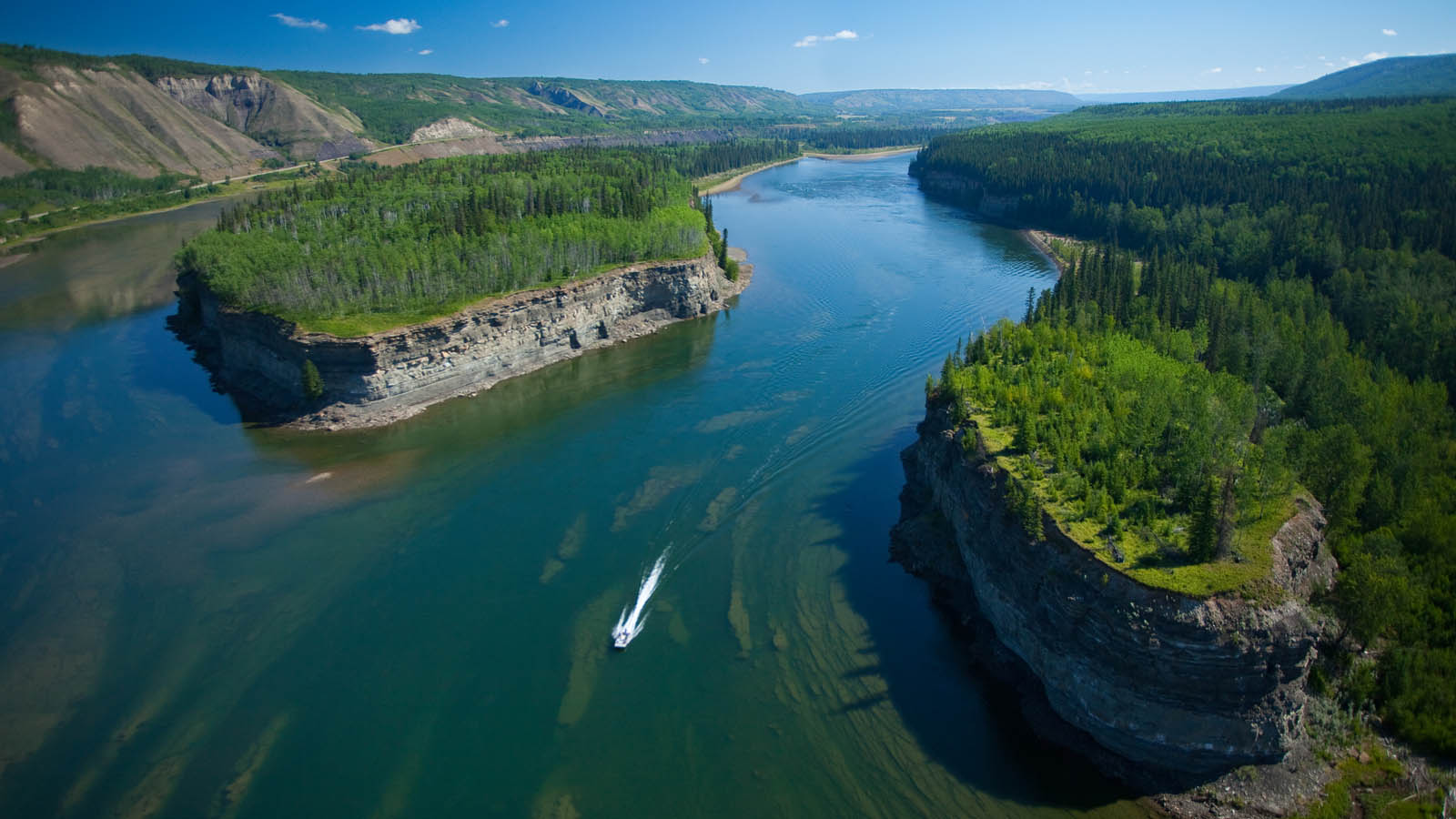 A jet boat travels a river under threat. Abundant outdoor and recreational opportunity will disappear due to Site C, and along with it, jobs it supports. GRAHAM OSBORNE PHOTO