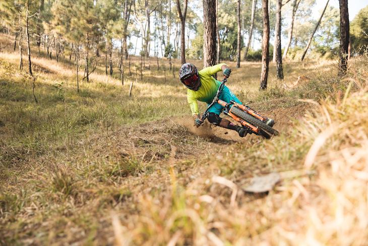 RJ riding his mountain bike doing a Matt Hunter handlebar drag