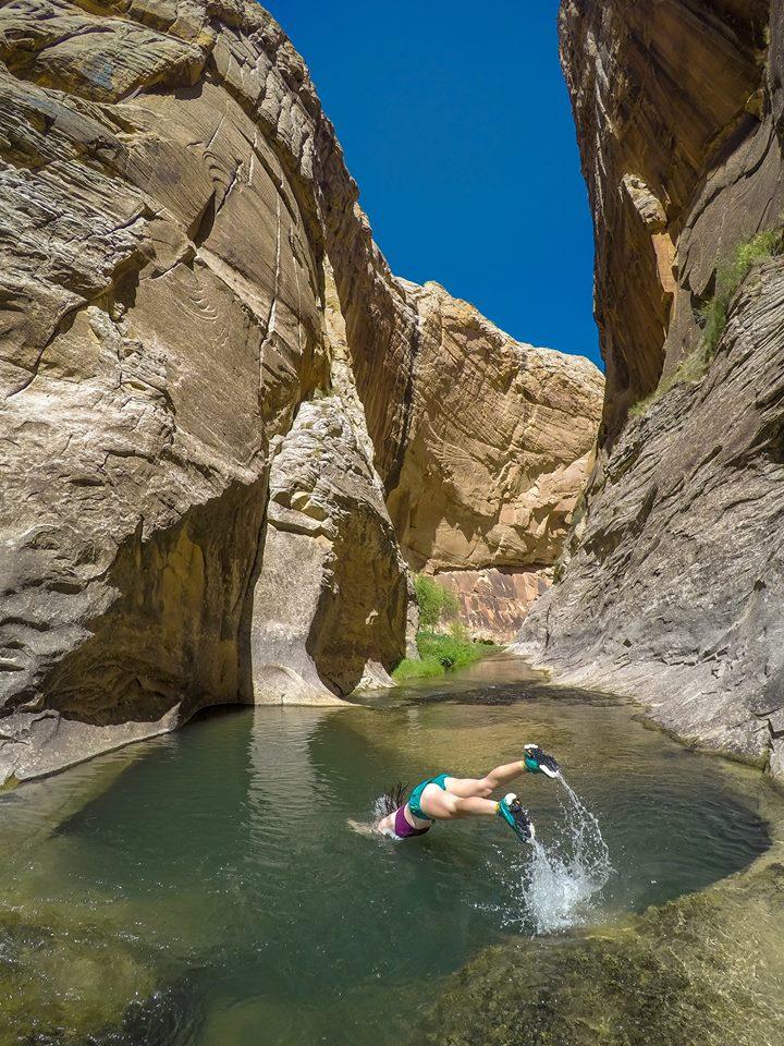 Corry Bondini Diving into a swimming hole on the Escalante River, Utah.