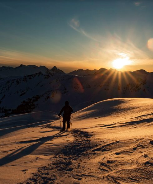 skier at sunset in the alpine