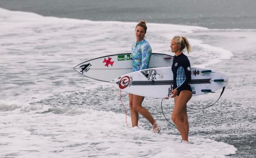 Paige Alms and Mathea Olin going surfing