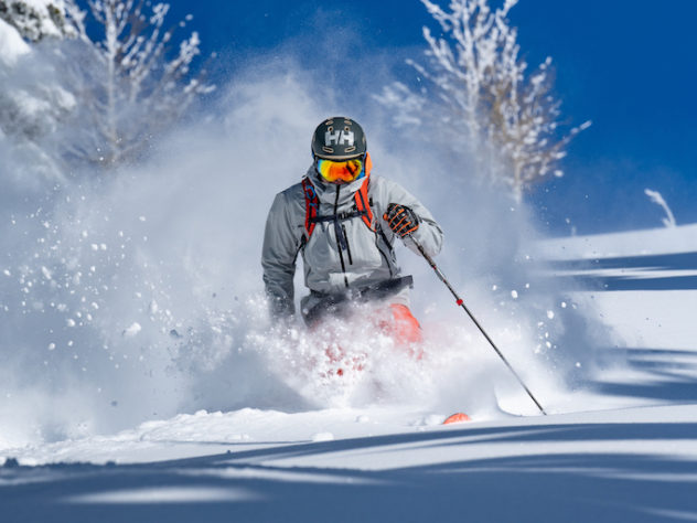 Helly-Hansen-Launches-Sustainable-LIFA-Infinity-Pro-Fabric-Elevation-Infinity-Shell-Jacket-skier-bluebird-day
