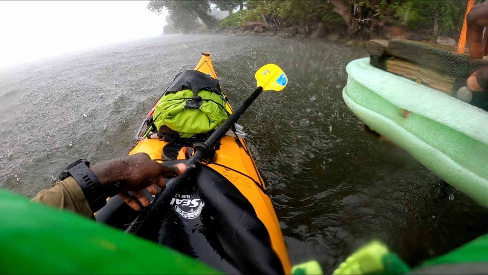 Mario-Rigby-Paddling-for-Social-and-Eco-Justice-GoPro-kayak-rain-Lake-Ontario
