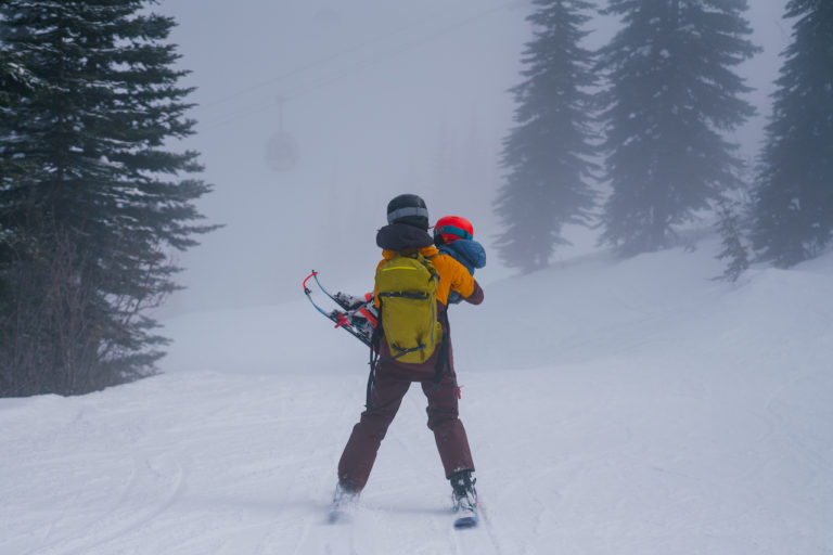 Motherload-A-Film-about-Children-Loss-and-Healing-in-the-Mountains-ZOYALYNCH_skier-holding-child