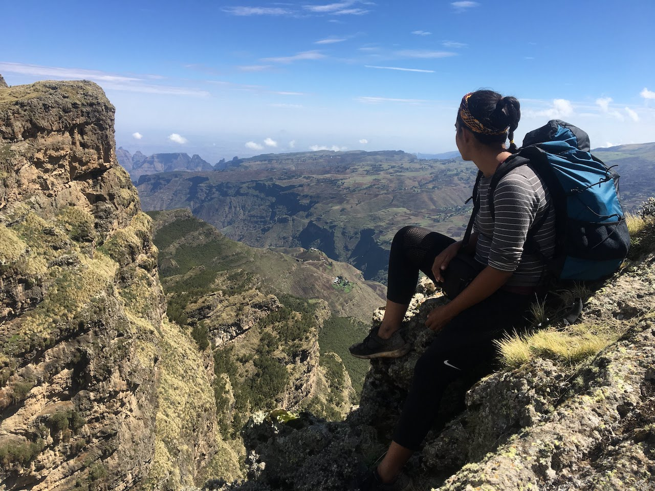 Trekking-Ethiopias-Simien-Mountains-Mafia-AK-47s-and-a-Park-at-Risk-backpacker-sitting-canyon