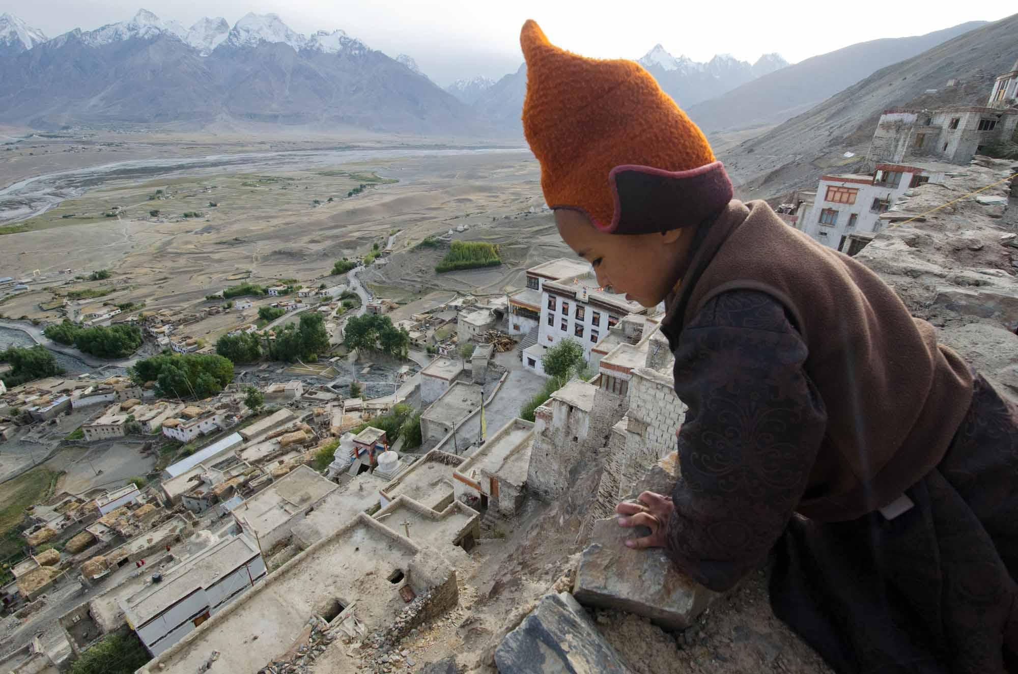 Blue-Sky-Kingdom-Family-Vacation-to-a-Buddhist-Monastery-KarshaGompa-BruceKirkby-Tibetan-child