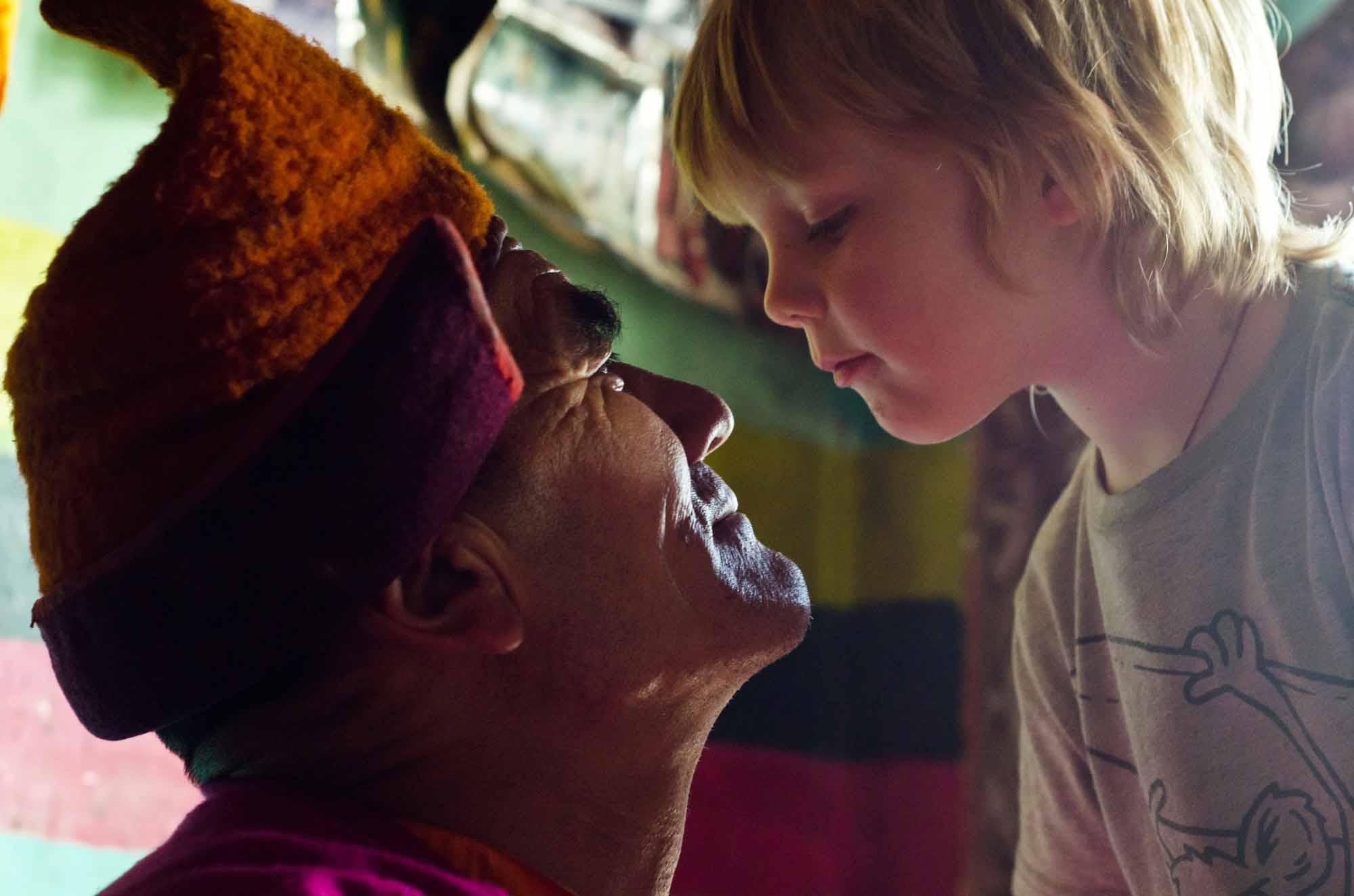 Blue-Sky-Kingdom-Family-Vacation-to-a-Buddhist-Monastery-KarshaGompa-BruceKirkby-child-and-teacher
