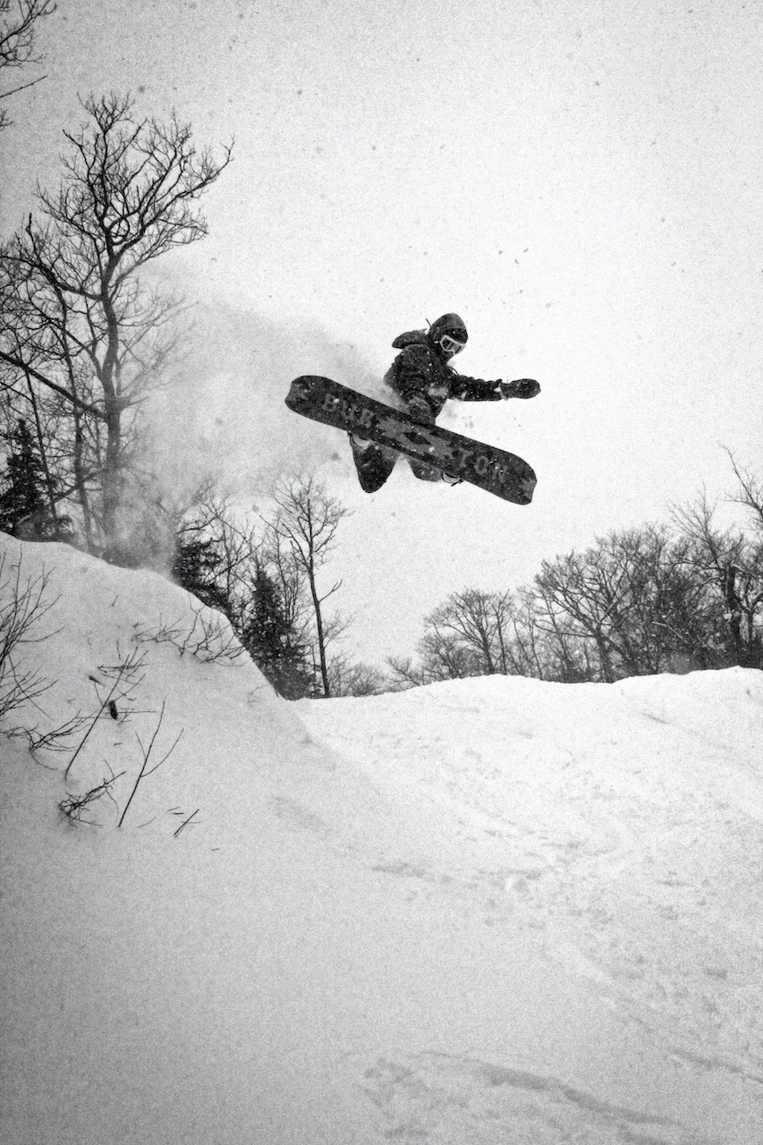 Mount-Bohemia-Champagne-Pow-on-a-Beer-Budget-Nelson-phillips-snowboarder-jump