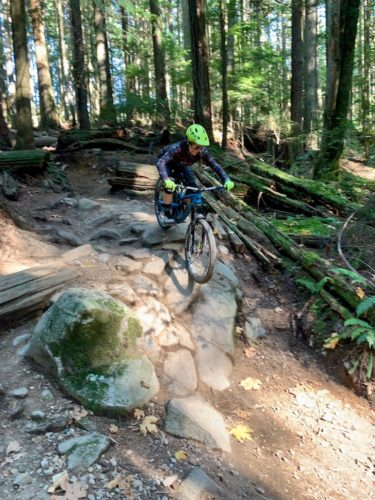 She-Summits-Opens-Dialogue-about-Femininity-in-the-Outdoors-Sarah-Fenton-Tippie-downhill-mountain-bike-green-helmet