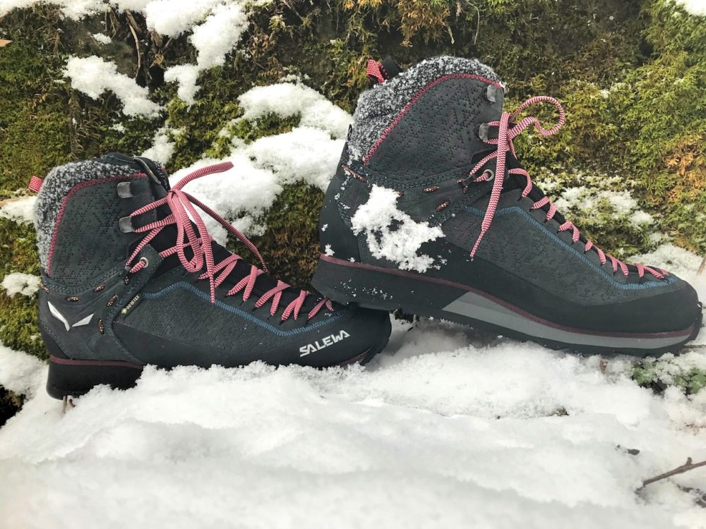 Tradition-Innovation-Salewa-Mountain-Trainer-2-Winter-Boot-side-snow-mossy-rocks