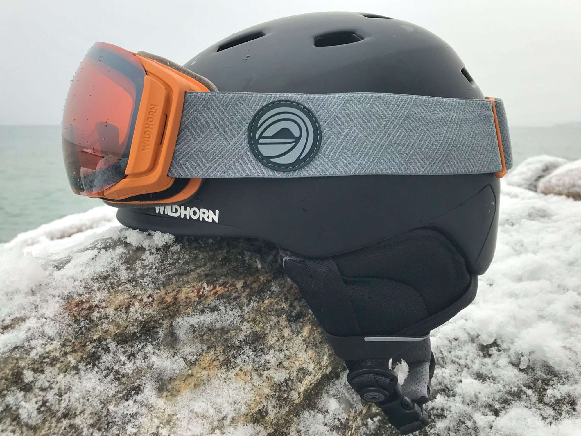 Wildhorn-Snow-Helmet-and-Goggles-Better-for-Less-helmet-and-goggles-on-rock