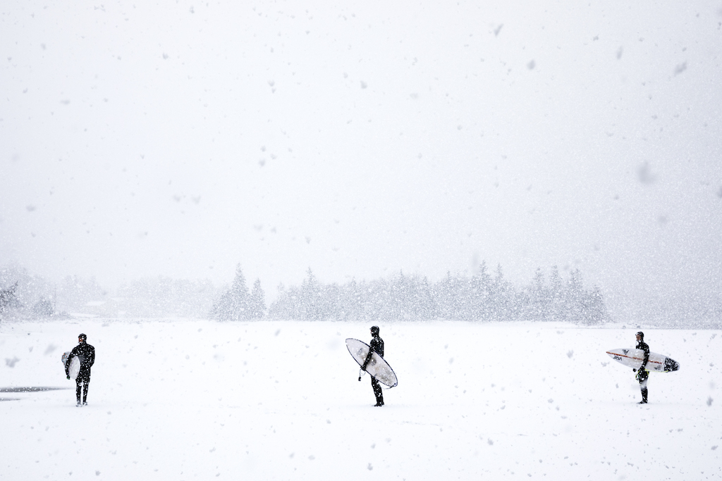 Boards-Blizzards-Winter-Surfing-Nova-Scotia-snowy-scene-three-surfers-photo-by-Marcus-Palladino