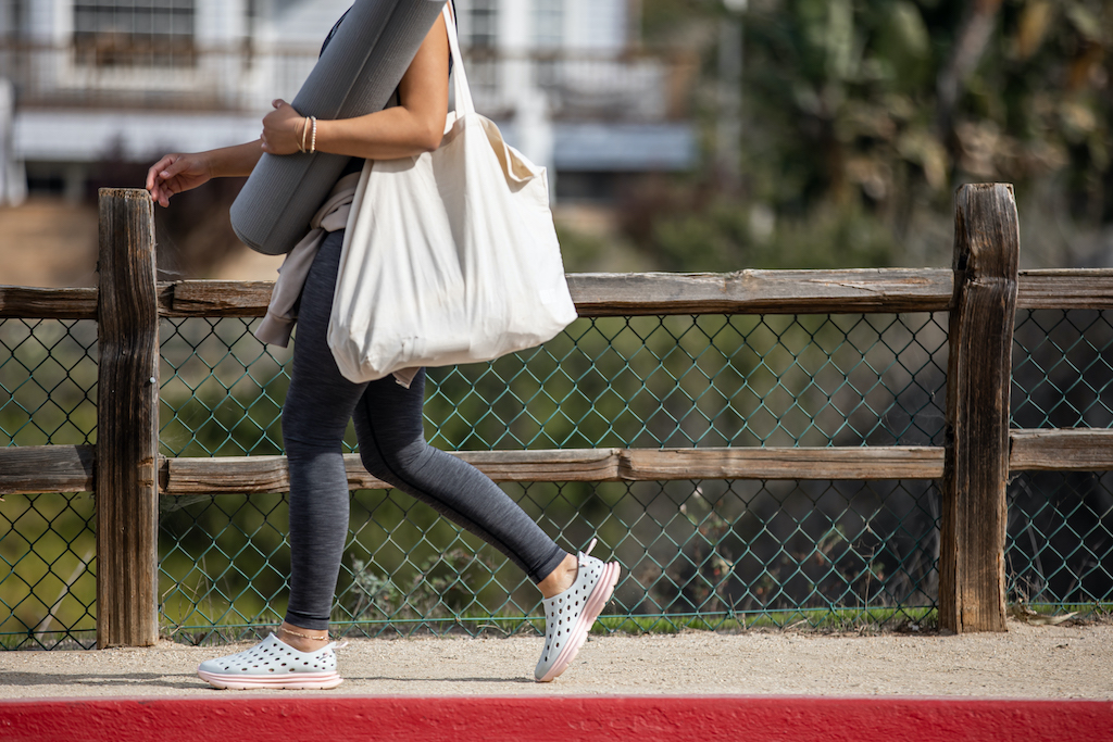 Kane-Revive-A New-Crop-of-Regenerative-Footwear-walking-with-yoga-mat