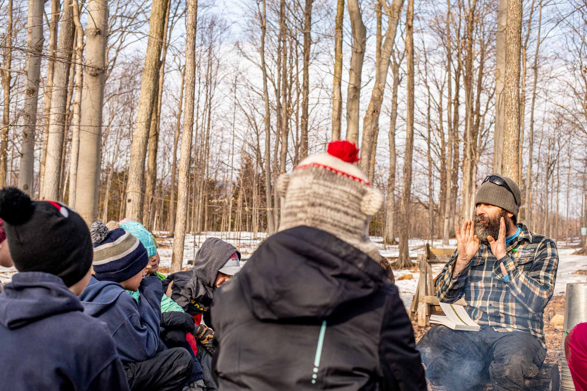 Nature-as-Teacher-Outdoor-Schools-Bring-Learning-Into-the-Elements-photo-by-Kristin-Schnelten-group-learning-about-birdcalls