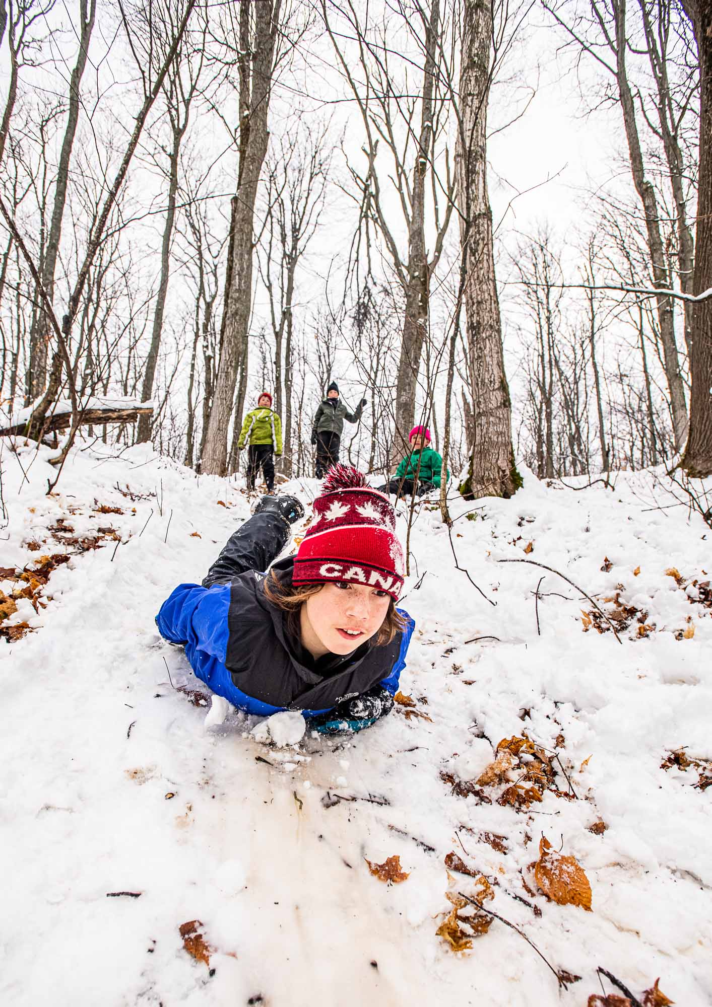 Nature-as-Teacher-Outdoor-Schools-Bring-Learning-Into-the-Elements-photo-by-Kristin-Schnelten-sliding-down-hill